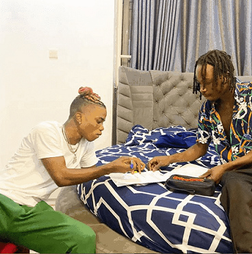 Naira Marley and Lyta Signing Official Document